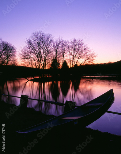 moored canoe by a twilight lake