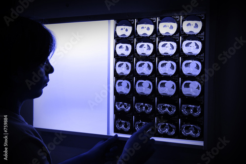 poster of doctor in surgical scrubs looking x-ray