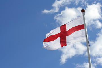 flag of st george against a blue sky (with room fo