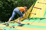 girl climbing rope ladder poster