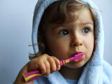 girl brushing teeth poster