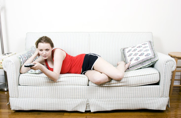 young woman with tv remote