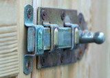 a metal lock on wood poster