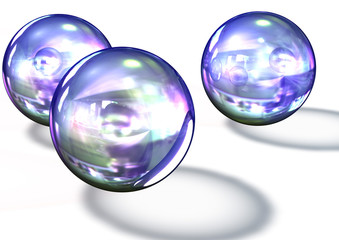 three reflective transparent glass balls