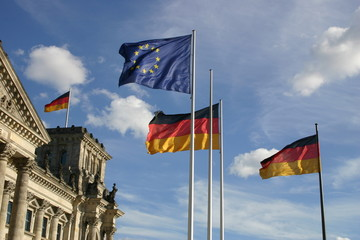 flags of germany and eu in front of parliament