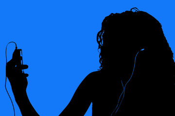 silhouette of teen with digital video player