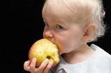 girl bitting apple poster