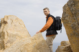 man climbing on the rocks poster