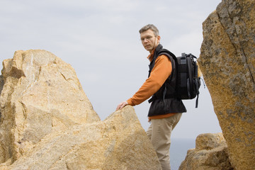 man climbing on the rocks