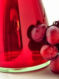 red wine in a glass and grapes poster