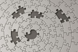 grey jigsaw with five missing pieces poster