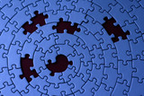 jigsaw in blue with five missing pieces poster