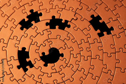 poster of abstract of a jigsaw with five missing pieces