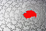 abstract of a silver jigsaw with missing pieces in the red cente poster