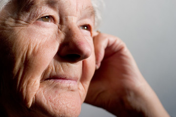 elderly woman contemplating