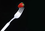 delicious strawberry on a fork poster