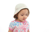 little girl wearing a hat poster