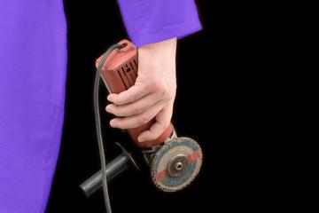 mechanic holding a cutting machine