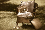 old wicker chair/ sepia tone poster