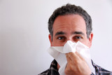 sick man blowing nose poster