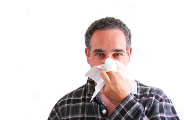 man with cold blowing nose