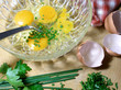 preparing a chives and parsley omelet