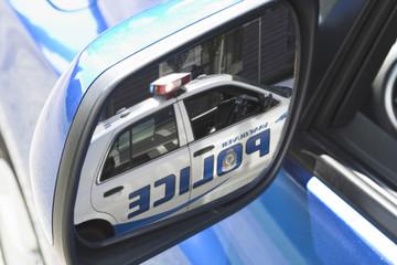 police car in mirror