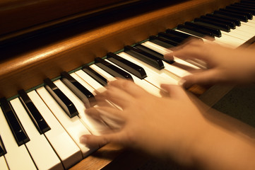 playing the piano-horizontal format