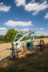 old plough in field