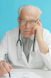 senior doctor with stethoscope poster