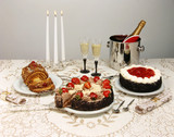 dessert table with cakes and champagne poster