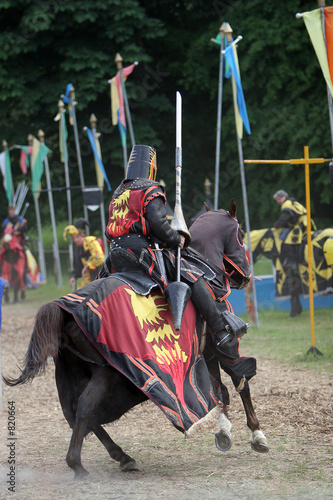 black knight preparing for jousting tournament