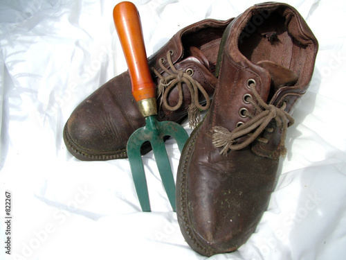old pair of shoes with trowel