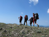 four people in the backpacking poster