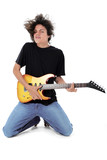 barefoot teen playing electric guitar over white poster