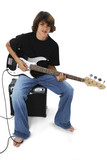 boy with black and white bass guitar sitting on am poster