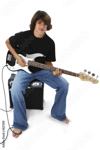 boy with black and white bass guitar sitting on am