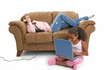 girls on couch, phone, laptop