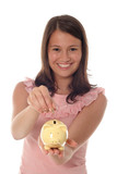 woman putting coin in piggy bank poster