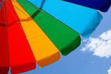 beach umbrella and sky poster
