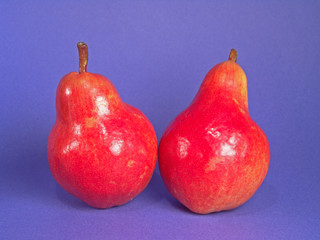 two red organic pears
