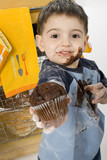 adorable toddler boy sharing chocolate muffin poster