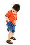 adorable toddler boy checking pockets for money poster