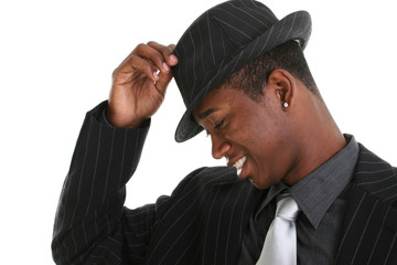 attractive young man tipping his hat