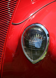 teardrop headlight on classic sports car poster