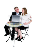 expecting couple sitting at table with computer poster