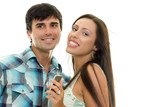 smiling couple enjoying music together poster