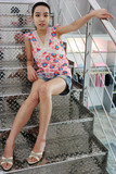girl sitting on silver stairs poster