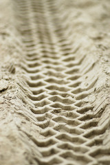 vehicle tracks in sand