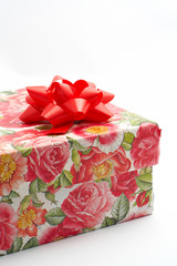 gift box with red ribbon, detail on white backgrou